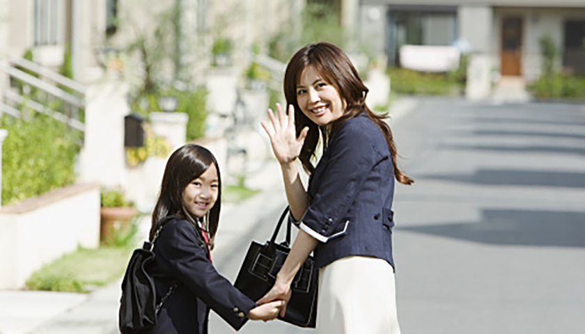Mother and daughter walking at the residential district